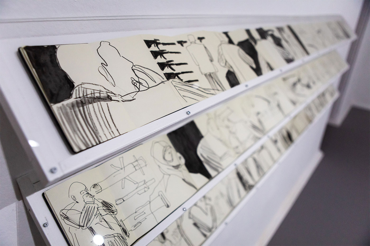 Jill Gibbon »Installation of sketchbooks drawn undercover at arms fairs - 2014-2019«, Exhibition View »Up in Arms«, Kunstraum Kreuzberg/Bethanien 2019 (Photo: Julian van Dieken)
